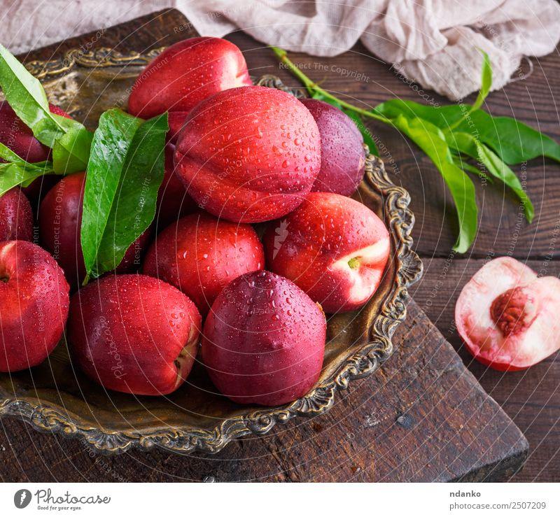 rote reife Pfirsiche Nektarine Frucht Dessert Ernährung Sommer Tisch Holz Essen frisch saftig braun Hintergrund Lebensmittel Gesundheit süß roh ganz