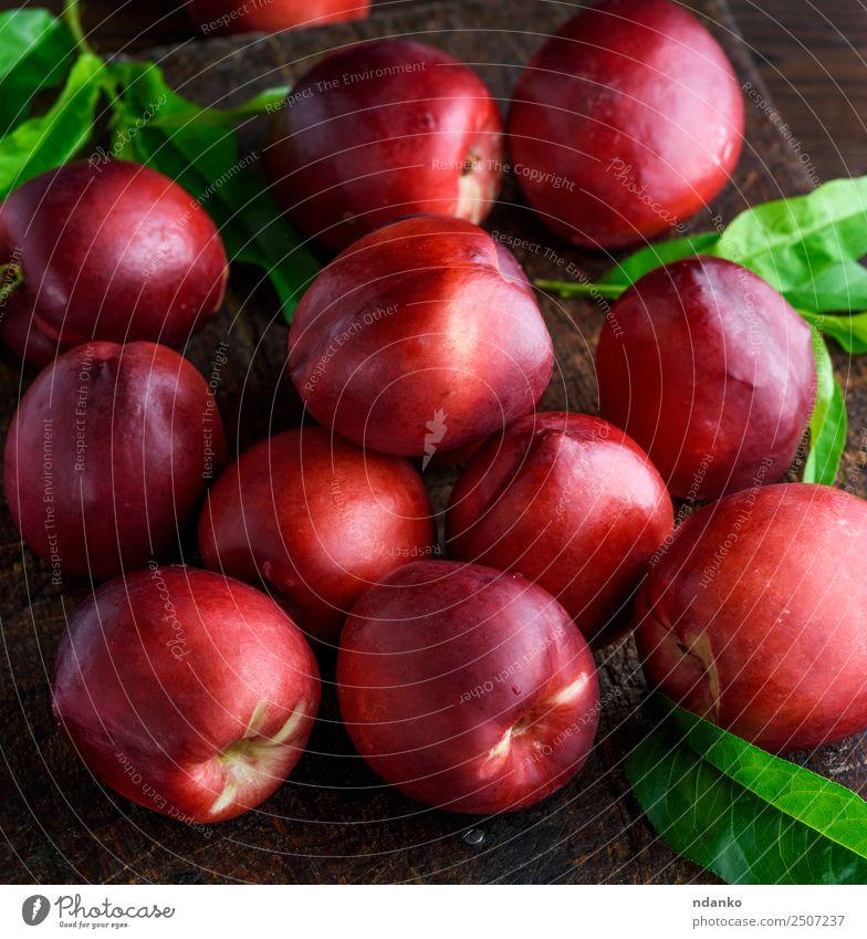 rote reife Pfirsiche Nektarine Frucht Dessert Ernährung Tisch Menschengruppe Blatt Holz Essen frisch saftig braun Hintergrund Lebensmittel Gesundheit süß roh
