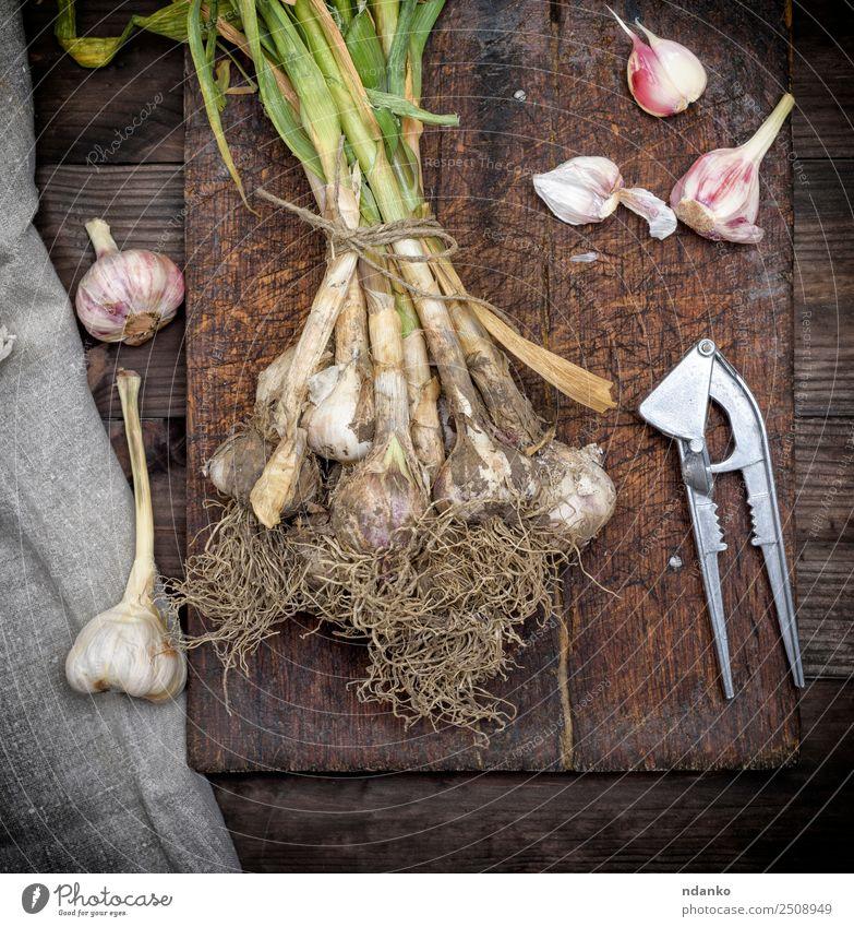 Bund frischer junger Knoblauch Gemüse Kräuter & Gewürze Ernährung Vegetarische Ernährung Natur Pflanze Blatt Holz natürlich oben grün weiß Hintergrund