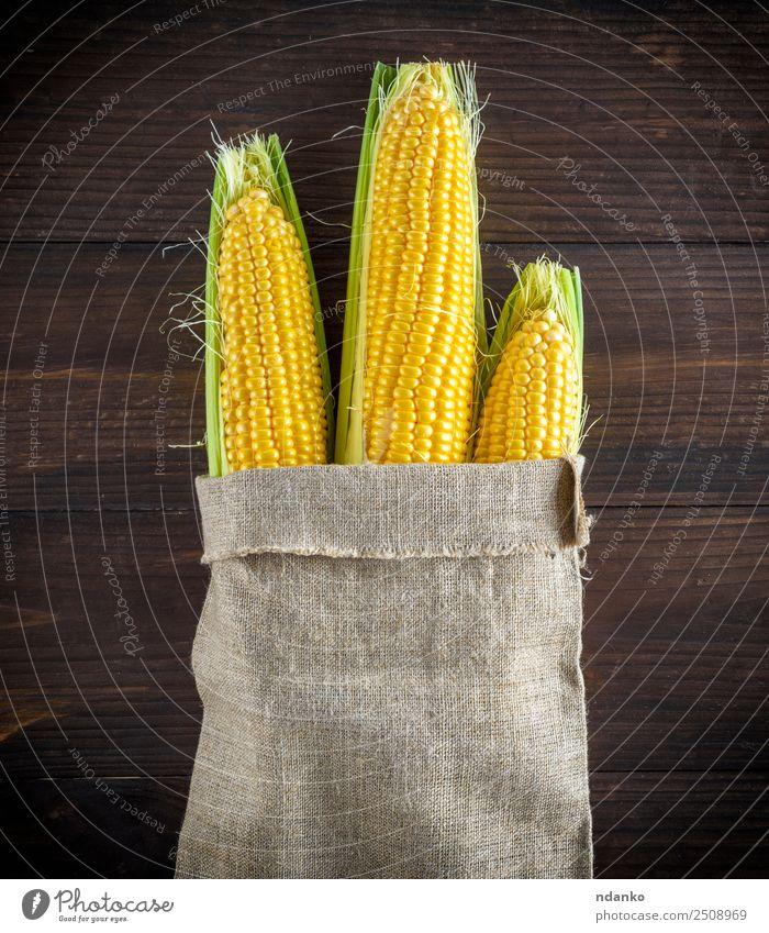 reife gelbe Maiskolben Gemüse Ernährung Vegetarische Ernährung Tisch Holz alt Essen frisch natürlich oben braun Tasche Kolben Ackerbau Hintergrund Bauernhof