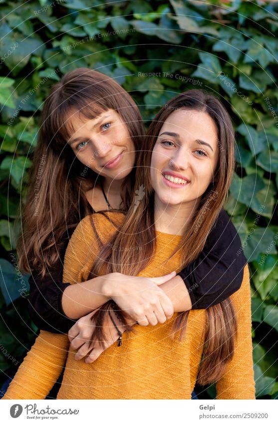 Nette Schwestern mit blauen Augen Lifestyle Freude Glück schön Leben Mensch Frau Erwachsene Familie & Verwandtschaft Freundschaft Jugendliche Zähne Park