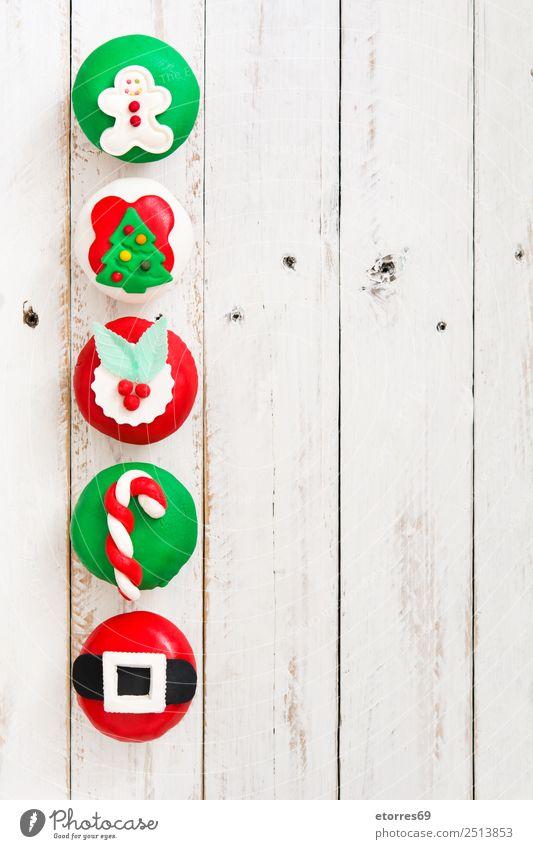 Weihnachtskuchen Lebensmittel Kuchen Dessert Süßwaren Weihnachten & Advent gut süß grün rot weiß Cupcake Jahreszeiten Weihnachtsbaum Zuckerstange Lebkuchenmann