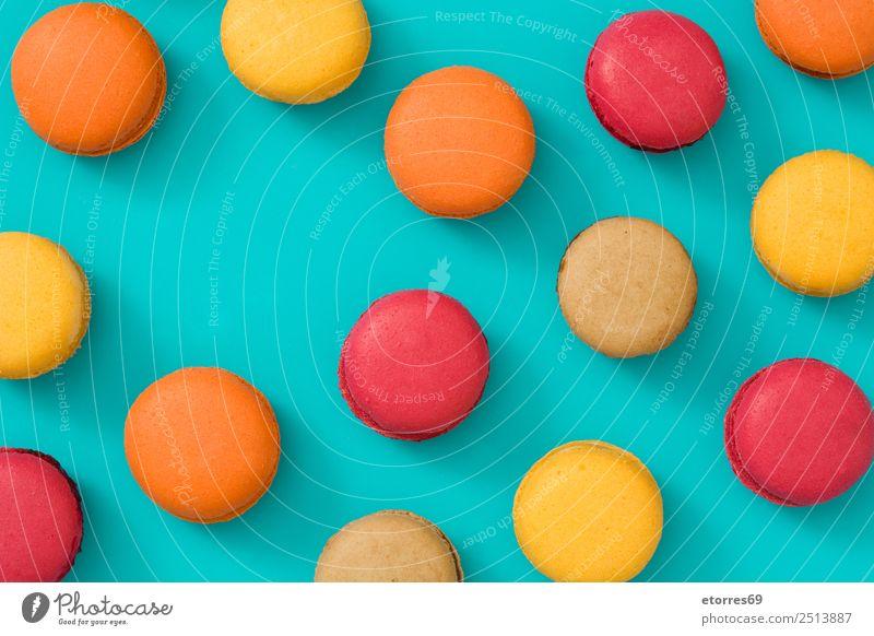 Französische Makronen Lebensmittel Kuchen Dessert Süßwaren Frühstück gut süß blau braun gelb orange rot türkis Farbe Foodfotografie Backwaren Bonbon Macaron