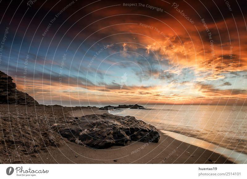Sonnenuntergänge am Mittelmeer Strand Umwelt Landschaft Himmel Wolken Sommer Felsen Wellen Küste Meer Stein authentisch schön einzigartig kuschlig rot Gefühle