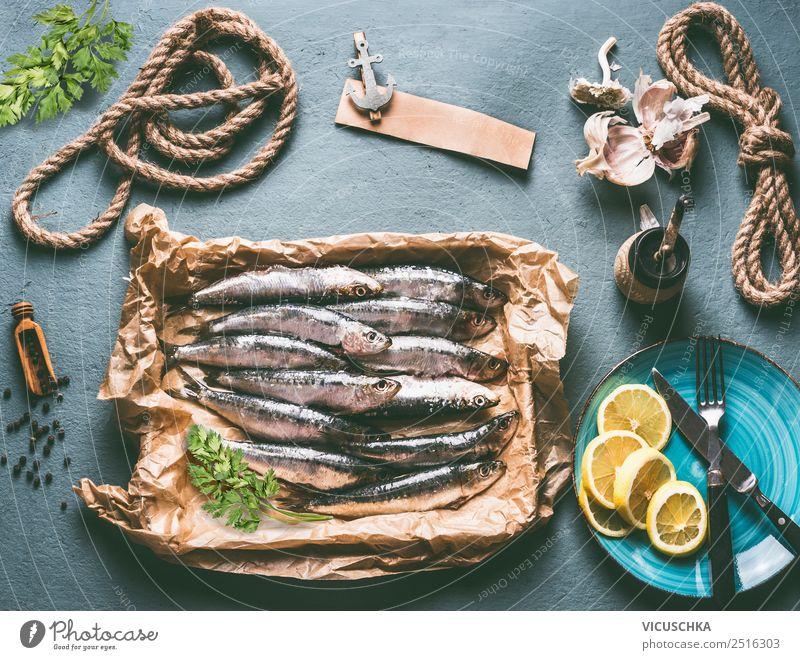 Sardinen auf dem Küchentisch mit Zutaten Lebensmittel Fisch Ernährung Mittagessen Abendessen Büffet Brunch Bioprodukte Vegetarische Ernährung Geschirr Teller