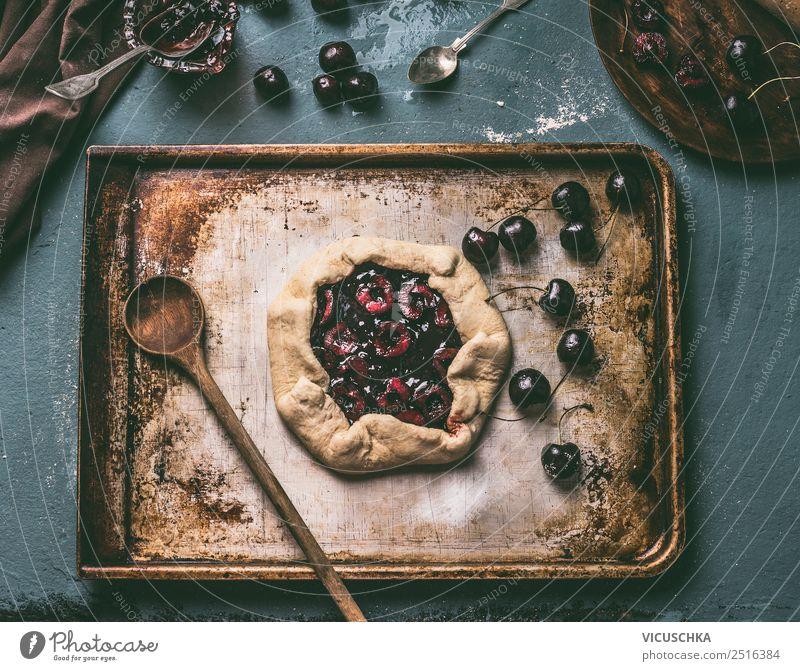Kirschen Kuchen zubereiten. Kirschen Galette Lebensmittel Frucht Teigwaren Backwaren Ernährung Bioprodukte Geschirr Stil Design Häusliches Leben Tisch Küche