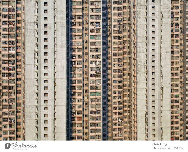 Menschenstaub Stadt bevölkert überbevölkert Hochhaus Architektur Fassade Häusliches Leben Armut dreckig groß Billig hässlich hoch Selbstlosigkeit Toleranz