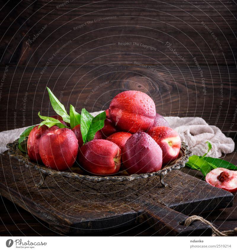 rote reife Pfirsiche Nektarine Frucht Dessert Ernährung Teller Schalen & Schüsseln Sommer Tisch Blatt Holz frisch oben saftig braun grün Hintergrund