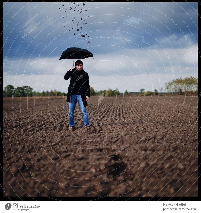 Why does it always rain on me Mann Jugendliche blau Wolken Einsamkeit schwarz Erwachsene Traurigkeit Kunst Feld maskulin Trauer Regenschirm Junger Mann Mantel