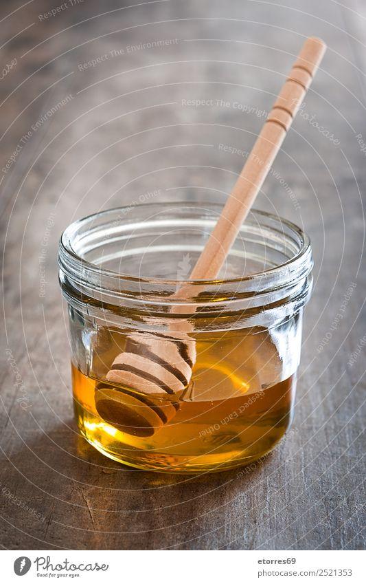 Honigdipper mit Honig im Glas auf Holz Lebensmittel Süßwaren Ernährung Diät Flasche Löffel Gesundheit Gesunde Ernährung Flüssigkeit süß Liebling liquide