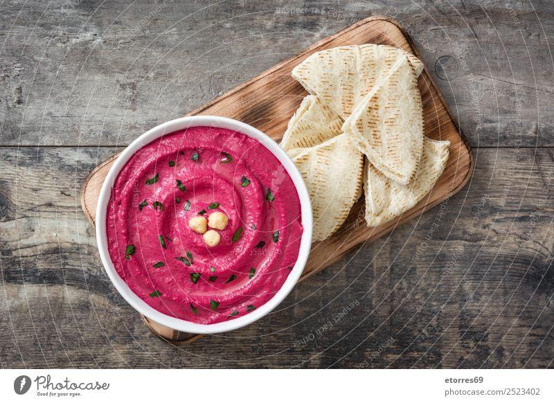 Rübenhummus in der Schüssel und Pita-Brot auf Holz Lebensmittel Ernährung Vegetarische Ernährung Diät Schalen & Schüsseln Gesunde Ernährung Tisch frisch Hummus