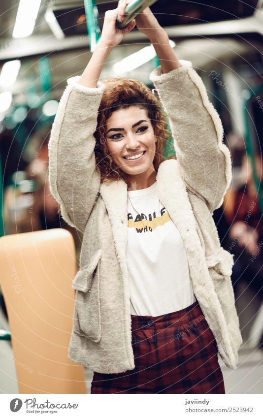 Lächelnde arabische Frau in der U-Bahn. Lifestyle schön Haare & Frisuren Ferien & Urlaub & Reisen Tourismus Ausflug Mensch Junge Frau Jugendliche Erwachsene 1