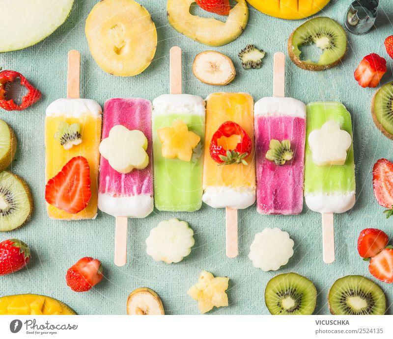 Eis am Stiel mit bunte Obst und Früchte Scheiben Lebensmittel Frucht Speiseeis Ernährung Stil Design Sommer Foodfotografie Beeren Essen Farbfoto