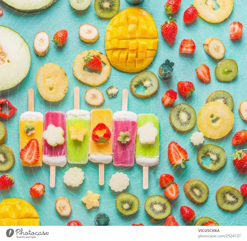 Bunte Eis am Stiel mit Obst und Beeren Zutaten Lebensmittel Frucht Speiseeis Ernährung Stil Design Gesunde Ernährung Sommer Hintergrundbild Mango Kiwi