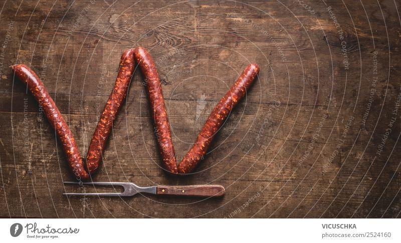 Buchstabe W gemacht mit Bratwürste Lebensmittel Wurstwaren Ernährung Gabel Stil Design Grill Hintergrundbild Text Symbole & Metaphern Buchstaben Bratwurst