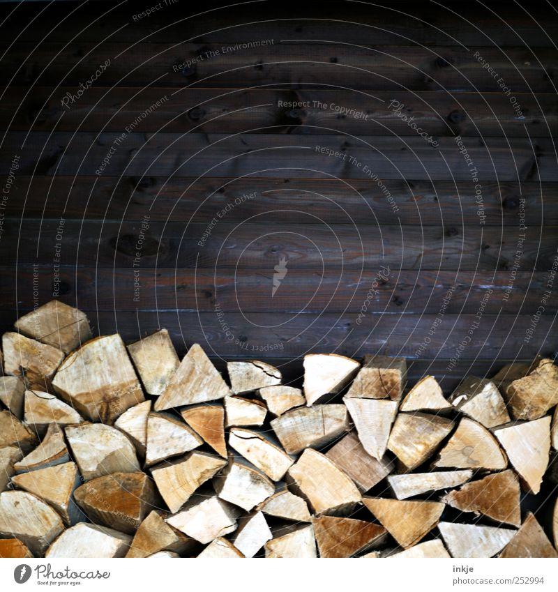 Brennholz Winter dunkel Wand Herbst Mauer braun hoch Ordnung Energie natürlich Energiewirtschaft planen Häusliches Leben viele trocken Reichtum
