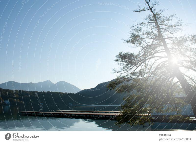 Anscheinend Himmel Natur blau Sonne Ferien & Urlaub & Reisen Sommer Ferne Berge u. Gebirge Landschaft See Ausflug wandern Schwimmen & Baden Tourismus Hügel Alpen