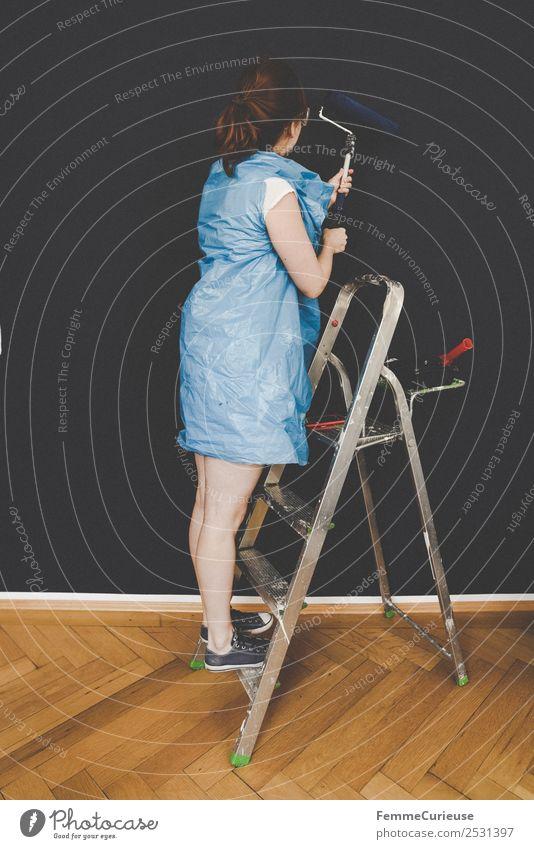 Woman in protective clothes coloring a wall with a paint roller Freizeit & Hobby feminin Frau Erwachsene 1 Mensch Kreativität Leiter malerleiter streichen