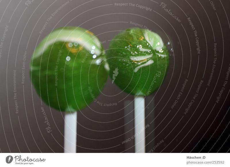 Lollypop Lollypop =) Süßwaren glänzend Glück saftig grau grün Freude Fröhlichkeit Lollipop lutschen Spiegel Spiegelbild Farbfoto Innenaufnahme Nahaufnahme