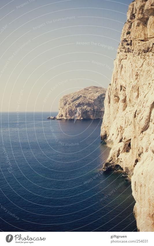 endless blue Umwelt Natur Landschaft Urelemente Wasser Himmel Wolkenloser Himmel Sommer Schönes Wetter Felsen Küste Meer Insel blau Landschaftsformen Meerwasser