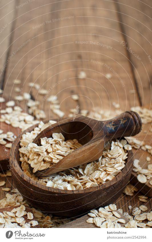 Haferflocken in einer Schüssel mit einem Löffel Ernährung Frühstück Vegetarische Ernährung Diät Schalen & Schüsseln Sommer Natur Holz natürlich Hintergrund