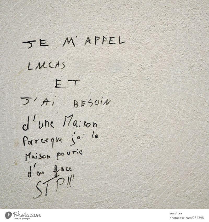 haus Mauer Wand Stein Beton Schriftzeichen Kommunizieren lesen grau Handschrift Nachricht französisch Text Schwarzweißfoto Außenaufnahme Detailaufnahme