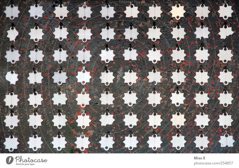 70 silber Stern (Symbol) Farbfoto Muster Menschenleer Plakette Zielscheibe Symmetrie viele Anordnung Reihe aufgereiht