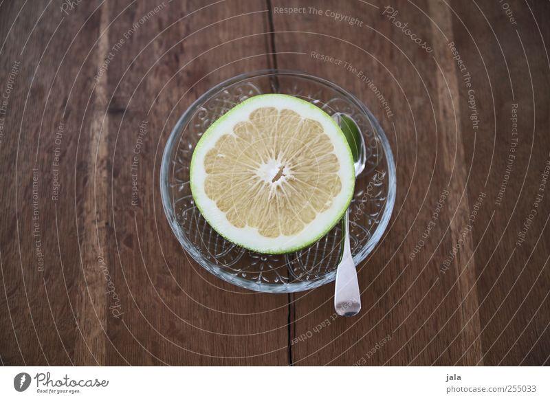 sweetie Lebensmittel Frucht Sweetie Ernährung Vegetarische Ernährung Diät Teller Löffel Gesundheit lecker sauer süß Zitrusfrüchte Holztisch Farbfoto