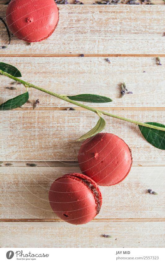 Rosa Makronen, auf hellem Holztisch Lebensmittel Dessert Frühstück Kaffee Tisch lecker rosa Farbe Tradition Macaron Hintergrund Pfirsich Teetrinken Französisch