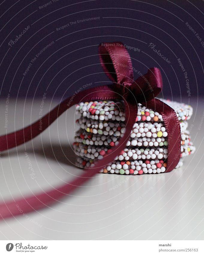 süßes Geschenk Dessert Süßwaren Schokolade Ernährung mehrfarbig Weihnachten & Advent Schleife Überraschung verpackt Punkt Stillleben Farbfoto Innenaufnahme