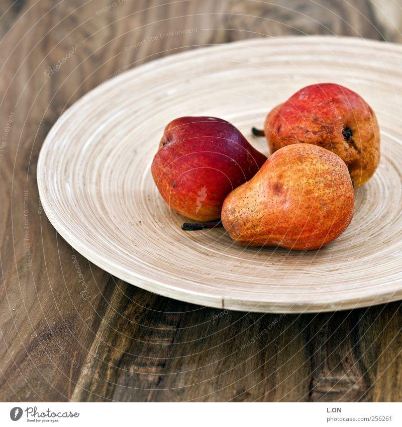 roteBirnen Lebensmittel Frucht Ernährung Bioprodukte Vegetarische Ernährung Schalen & Schüsseln Tisch Küche Holz lecker saftig süß Farbfoto Gedeckte Farben