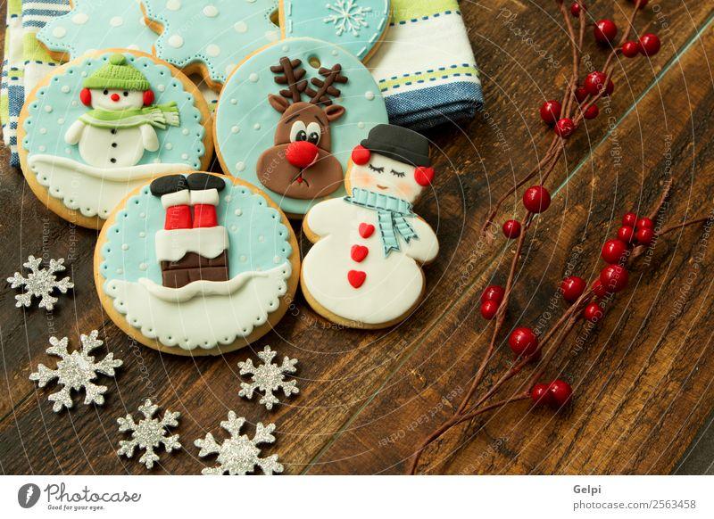 Weihnachten & Advent blau Winter Holz Feste & Feiern braun Dekoration & Verzierung Tisch lecker Jahreszeiten Tradition Dessert Backwaren Zucker Snack festlich
