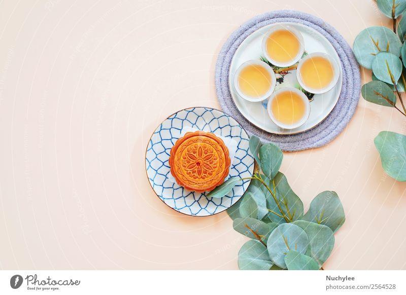 Draufsicht auf den chinesischen Mondkuchen Dessert Tee Design Glück schön Dekoration & Verzierung Feste & Feiern Kunst Kultur Pflanze Blume Blatt frisch heiß