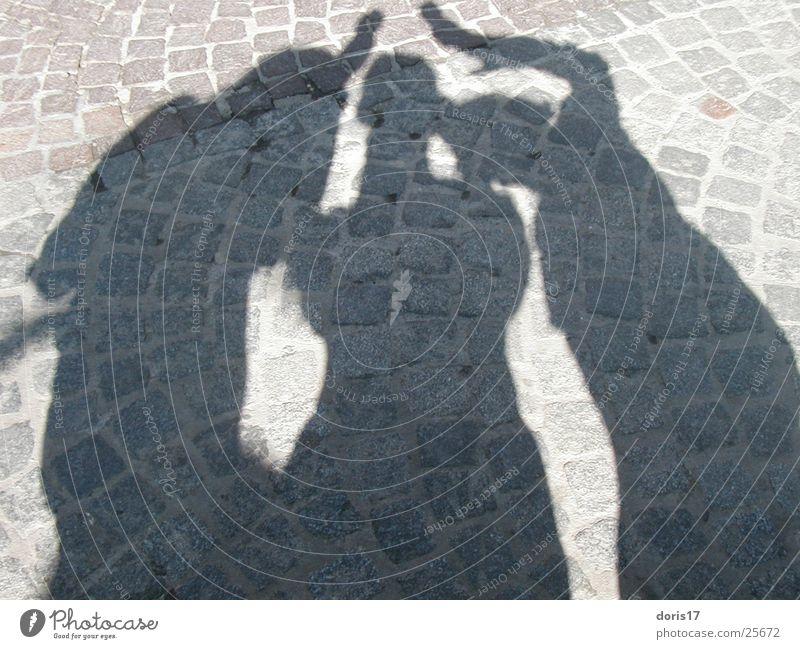 Schatten Frau abstrakt Mensch Sonnenschatten Kombination Pflastersteine