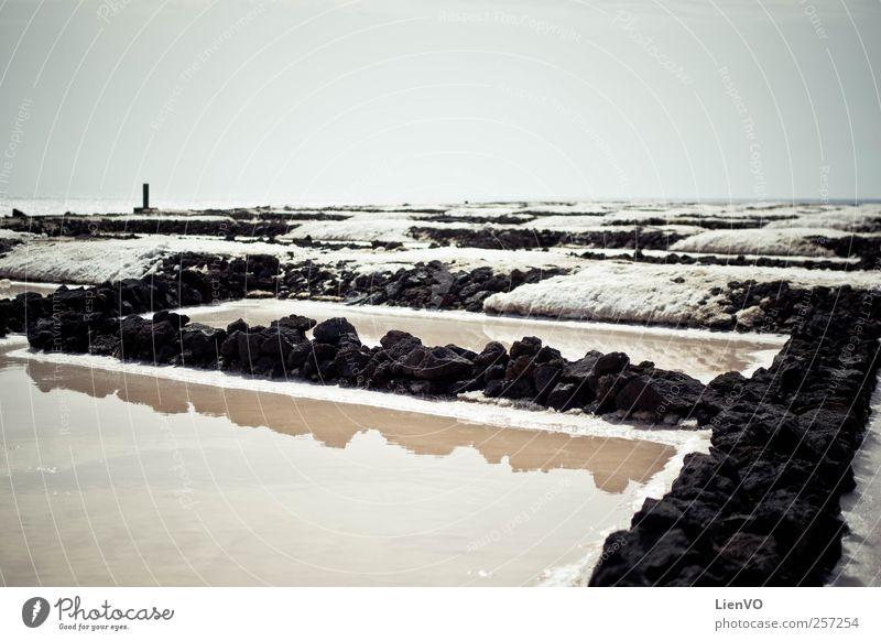 Natur Wasser Sonne Sommer Strand schwarz dunkel Landschaft Sand Wärme Stein Küste träumen Zufriedenheit Erde Wind