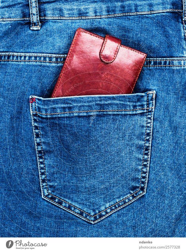 braune Ledergeldbörse Geld Kapitalwirtschaft Business Mode Bekleidung Hose Jeanshose Stoff blau Risiko Rücken Leinwand Entwurf Baumwolle Jeansstoff finanziell