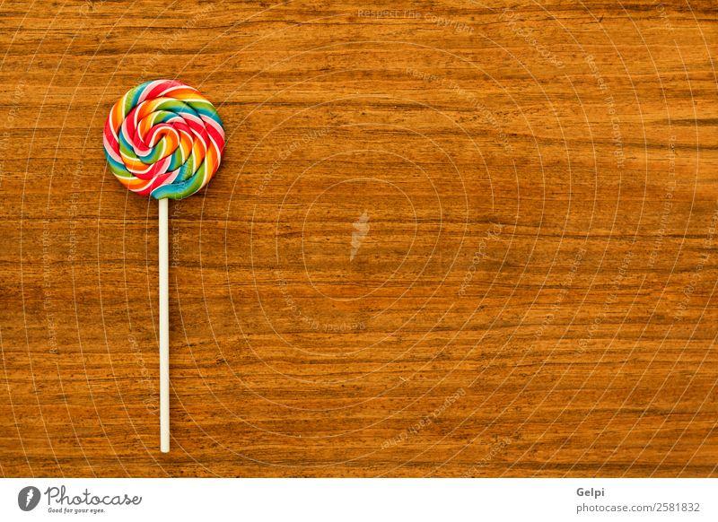 Schöner Lolli Dessert Essen Freude Kindheit Holz lecker retro rot weiß Farbe Bonbon Lebensmittel Lollipop süß Kies Zucker farbenfroh kleben Hintergrund ungesund