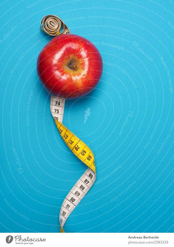 Apfel mit Maßband, Kalorien zählen, Weihnachten, Diät, Abnehmen Lebensmittel Frucht Bioprodukte Vegetarische Ernährung Fasten Lifestyle Gesundheit