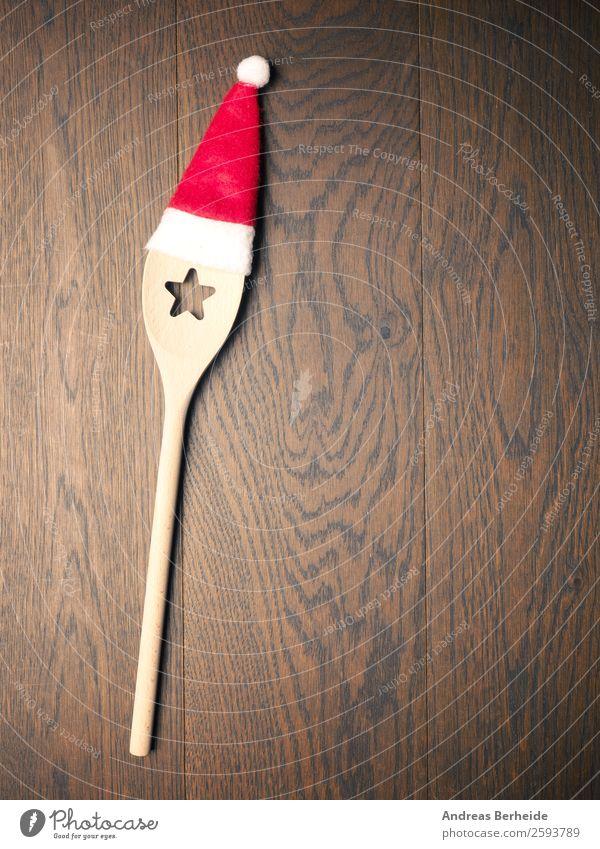 In der Weihnachtsküche Festessen Löffel Stil Winter Restaurant Weihnachten & Advent Hut Mütze Kochlöffel Kitsch lustig Weihnachtsmann cooking Hintergrundbild