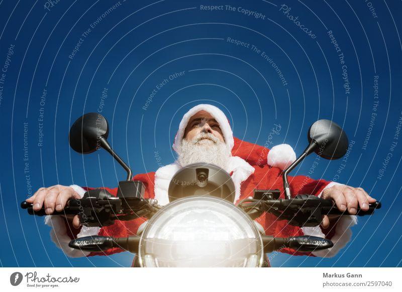 Weihnachtsmann auf dem Motorrad Freude Winter Weihnachten & Advent Mensch maskulin Mann Erwachsene Bart 45-60 Jahre blau rot Motorradfahrer Hintergrundbild