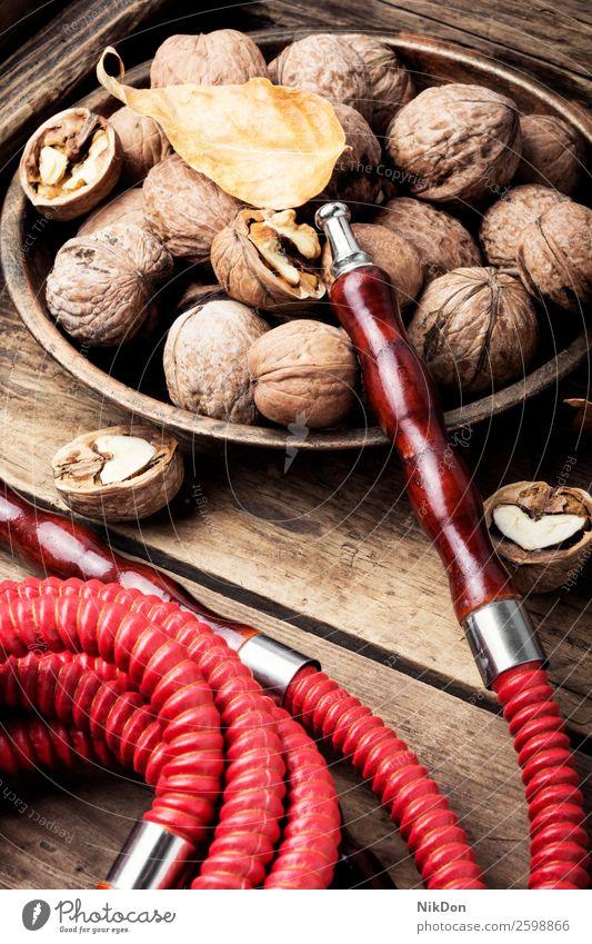 Wasserpfeife mit Aroma-Walnuss Wasserpfeifenrauch shisha Walnussholz Rauchen Tabak nargile Apfel Nikotin Osten Erholung Frucht arabisch Mundstück Röhren duftig