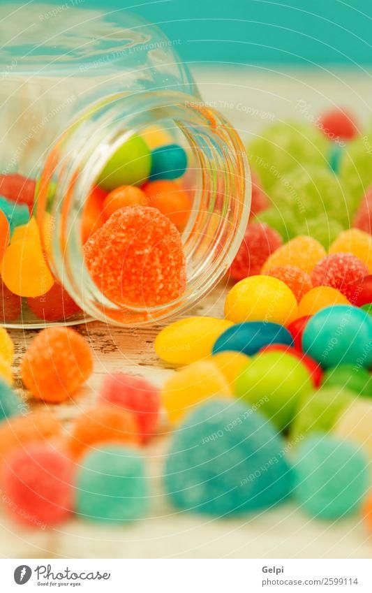 Bunte Geleebohnen in verschiedenen Größen nahe der Tapete Frucht Dessert Süßwaren Feste & Feiern Geburtstag Kindheit Menschengruppe außergewöhnlich hell lecker