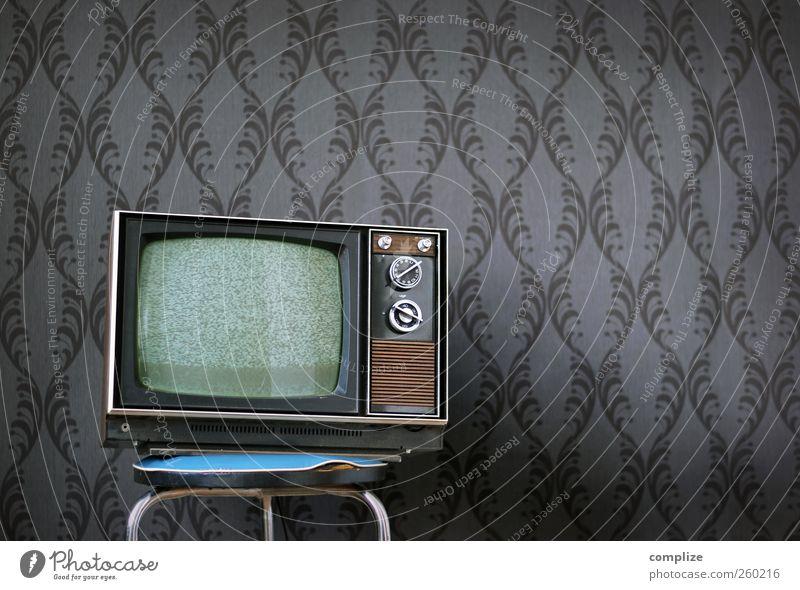 Tele-Vision Innenarchitektur grau Büro Raum Wohnung Idylle Häusliches Leben Dekoration & Verzierung Zukunft Vergänglichkeit retro Stuhl Fernseher Fernsehen Vergangenheit Tapete