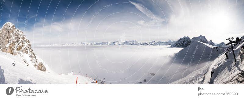 Nebelmeer von oben Leben Tourismus Winter Schnee Winterurlaub Berge u. Gebirge Wintersport Skifahren Skipiste Landschaft Himmel Wolken Sonne Felsen Alpen Gipfel