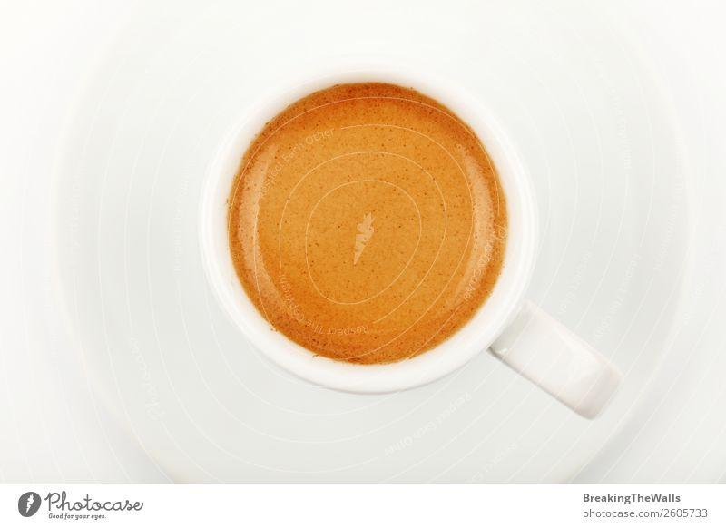 Nahaufnahme Espressotasse über Weiß direkt darüber Frühstück Kaffeetrinken Getränk Heißgetränk Becher heiß braun weiß Crema Bierschaum Schaum Ristretto