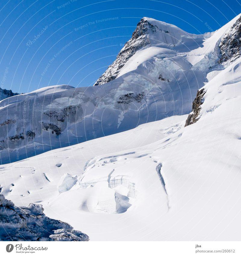 Hochgebirge ruhig Ausflug Abenteuer Freiheit Expedition Sonne Winter Schnee Winterurlaub Berge u. Gebirge Klettern Bergsteigen Natur Schönes Wetter Felsen Alpen