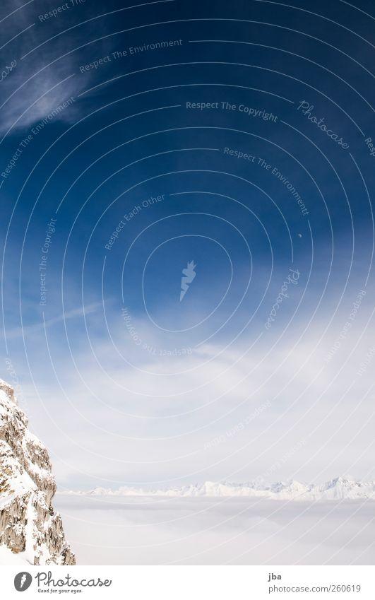 über dem Nebelmeer links Himmel Natur blau weiß schön Winter Ferne Schnee Berge u. Gebirge Freiheit Luft Zufriedenheit Felsen wild Urelemente Neugier