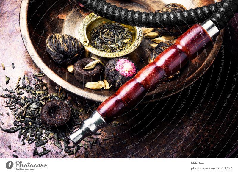 Wasserpfeife mit Aromatee Wasserpfeifenrauch shisha Tee Rauchen Tabak nargile Nikotin Osten Erholung Frucht arabisch Mundstück Röhren duftig Zeitvertreib