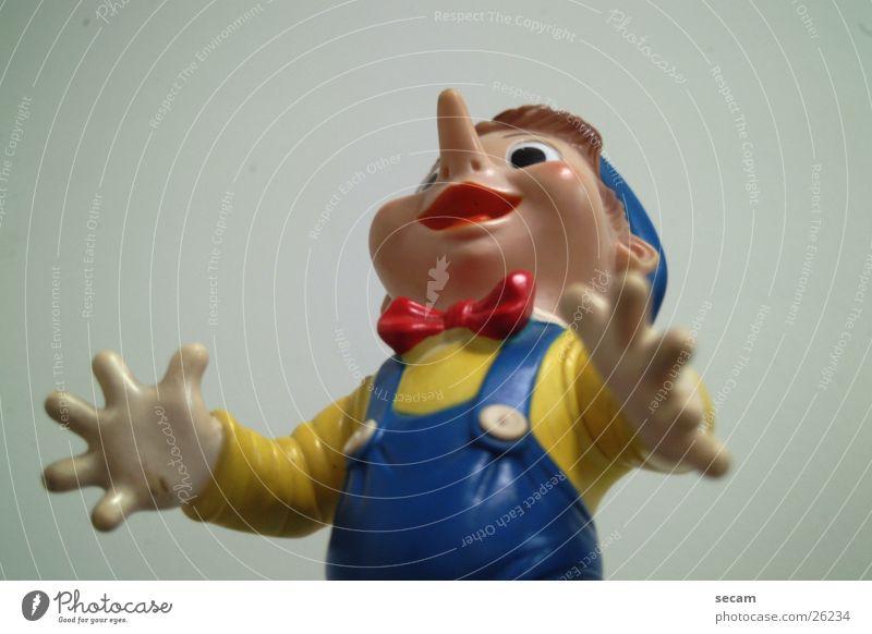pinocchio_1 Spielfigur Spielzeug Statue Puppe Blick