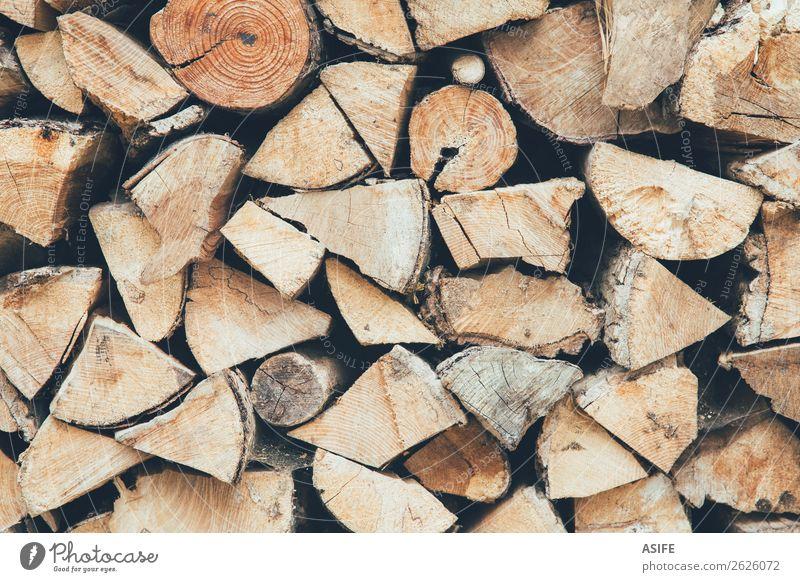 Brennholzstapel Hintergrund Winter Natur Herbst Baum Holz natürlich braun Energie Nutzholz Totholz Konsistenz Haufen Anhäufung Stapel Holzschuppen organisiert